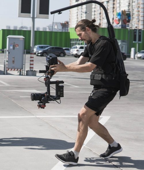 Image of our staff at  Elite Video of Frisco shoowing some footage out in a parking lot.
